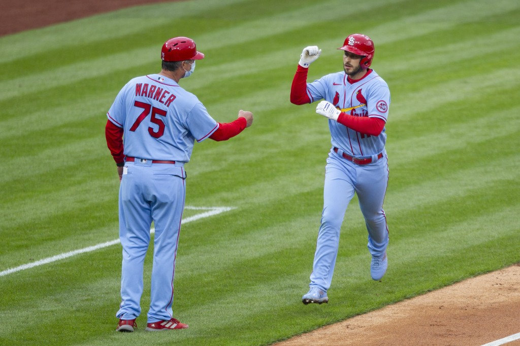 St. Louis Cardinals' Paul DeJong, right, is congratulated by third base coach Ron 'Pop' Warner, left, after hitting a home run during the third inning...