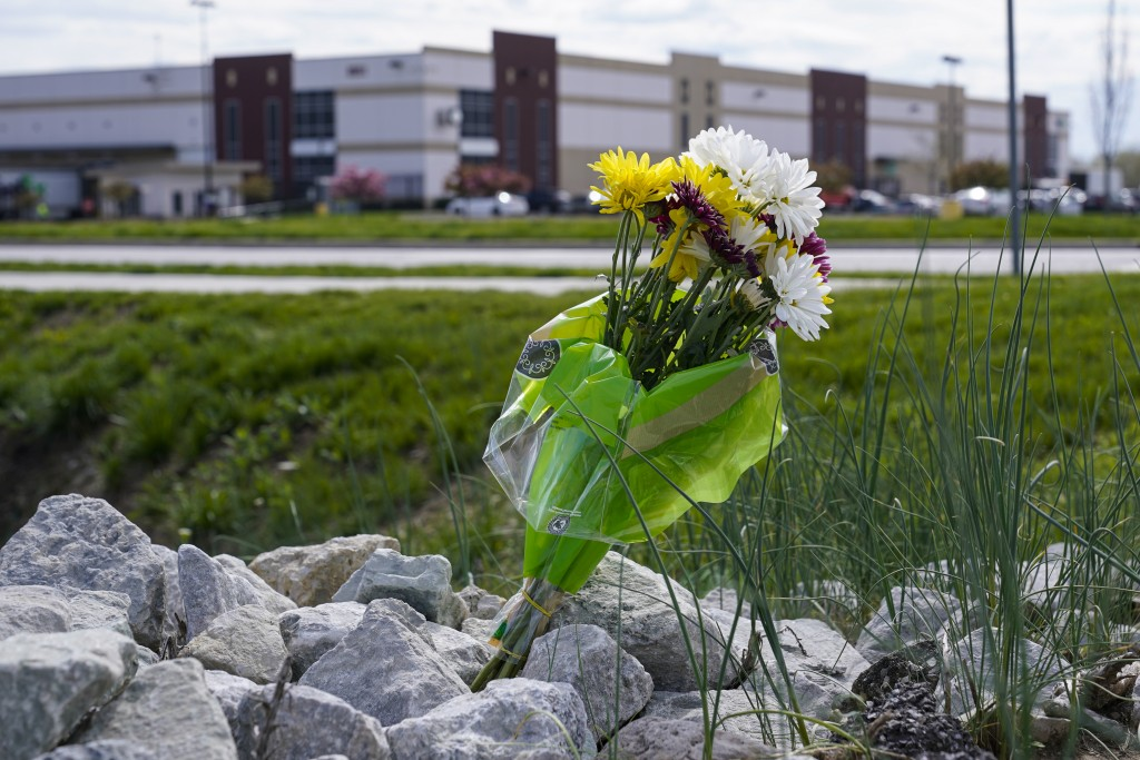 A single bouquet of flower sits in the rocks across the street from the FedEx facility in Indianapolis, Saturday, April 17, 2021 where eight people we...