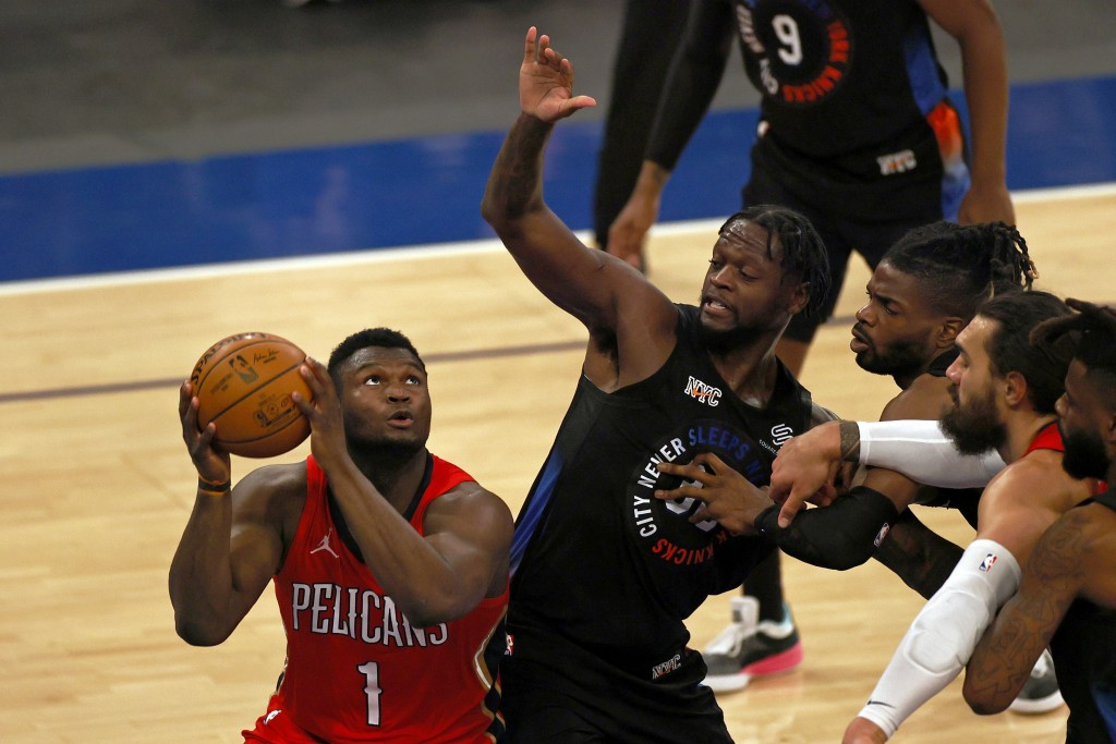 New Orleans Pelicans forward Zion Williamson (1) drives to the basket against New York Knicks forward Julius Randle during the first half of an NBA ba...