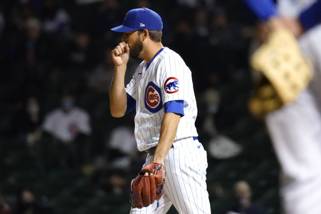 Chicago Cubs relief pitcher Ryan Tepera blows on his throwing hand during the sixth inning of a baseball game against the Atlanta Braves in Chicago, S...