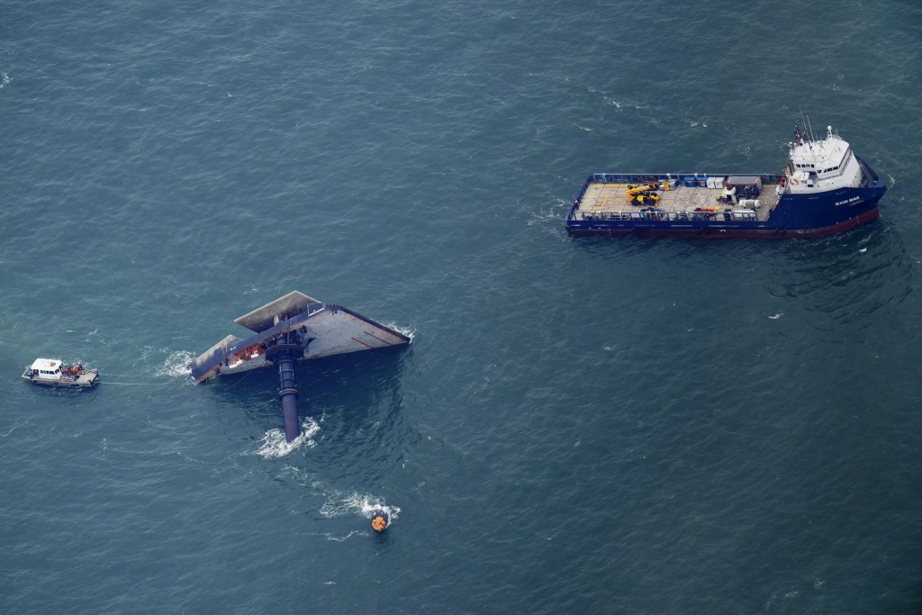 Rescue boats are seen next to the capsized lift boat Seacor Power seven miles off the coast of Louisiana in the Gulf of Mexico Sunday, April 18, 2021....