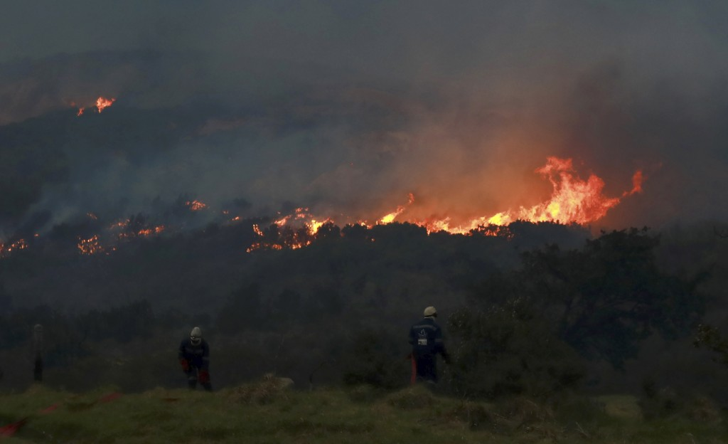 A fire rages on the slopes of Table Mountain, in Cape Town South Africa, Monday, April 19, 2021. Residents are being evacuated from Cape Town neighbor...