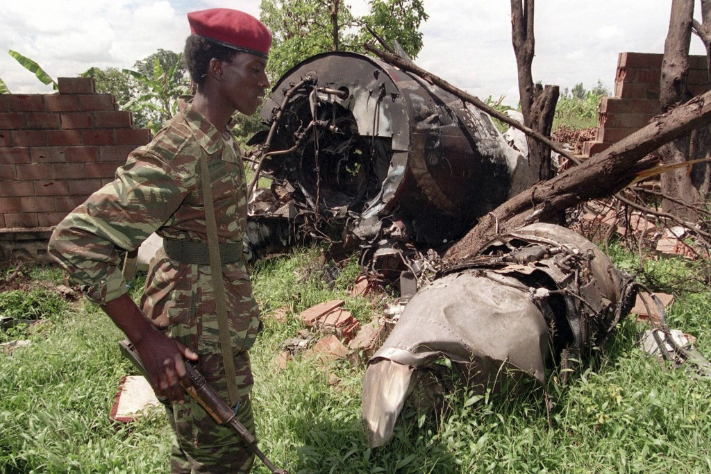 FILE - In this May 23, 1994 file photo, a Rwanda Patriotic Front (RPF) rebel walks by the the site of an April 6 plane crash which killed Rwanda's Pre...