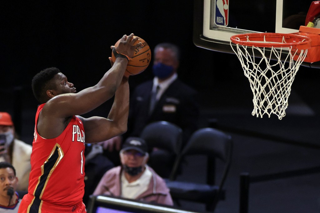 New Orleans Pelicans forward Zion Williamson (1) dunks the ball against the New York Knicks during the second half of an NBA basketball game Sunday, A...