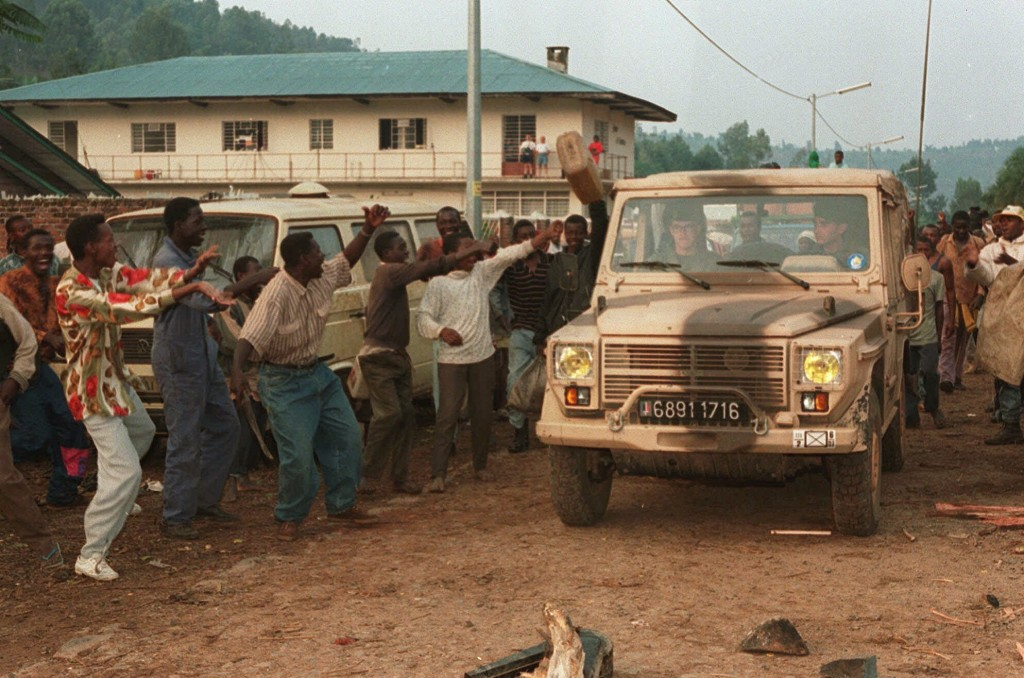 FILE - In this August 21, 1994 file photo, Rwandan Hutus give the departing French troops the thumbs-up as the French army pull out of Cyangugu, in so...