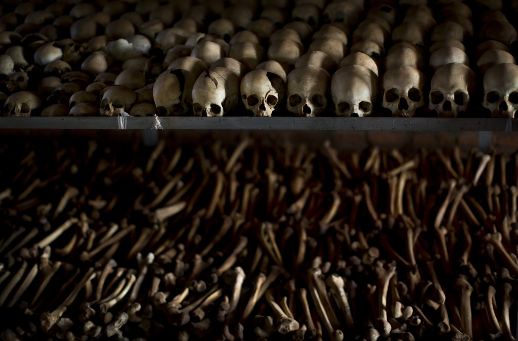 FILE - In this Friday, April 4, 2014 file photo, the skulls and bones of some of those who were slaughtered as they sought refuge inside the church ar...
