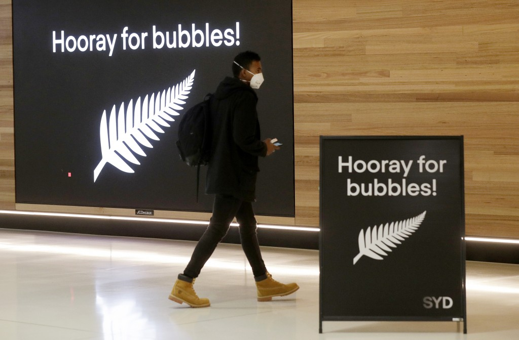 A passenger prepares at Sydney Airport, in Sydney, Australia, Monday, April 19, 2021, to catch a flight to New Zealand as the much-anticipated travel ...