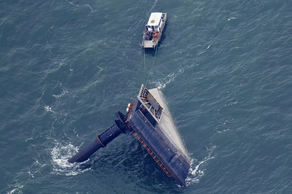 A rescue boat is seen next to the capsized lift boat Seacor Power seven miles off the coast of Louisiana in the Gulf of Mexico Sunday, April 18, 2021....