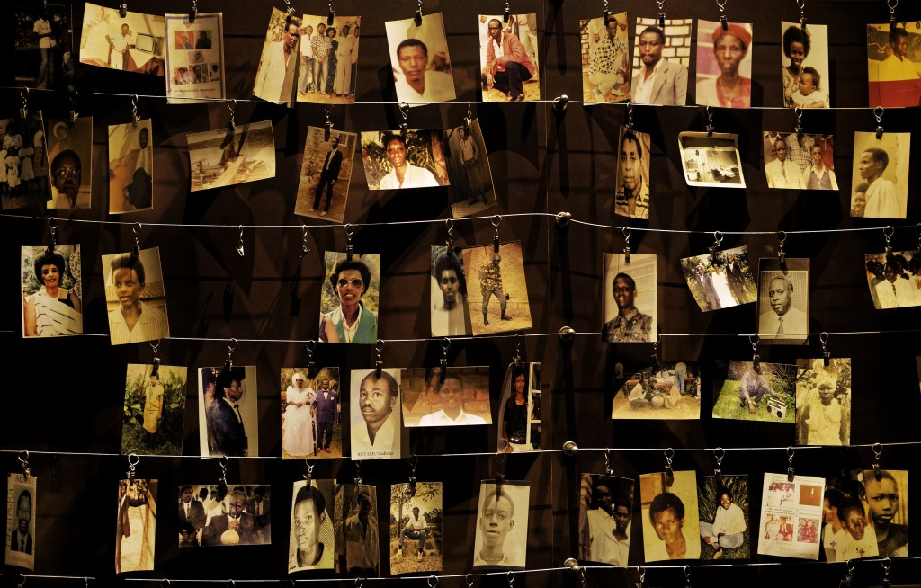 FILE - In this Friday, April 5, 2019 file photo, family photographs of some of those who died hang on display in an exhibition at the Kigali Genocide ...