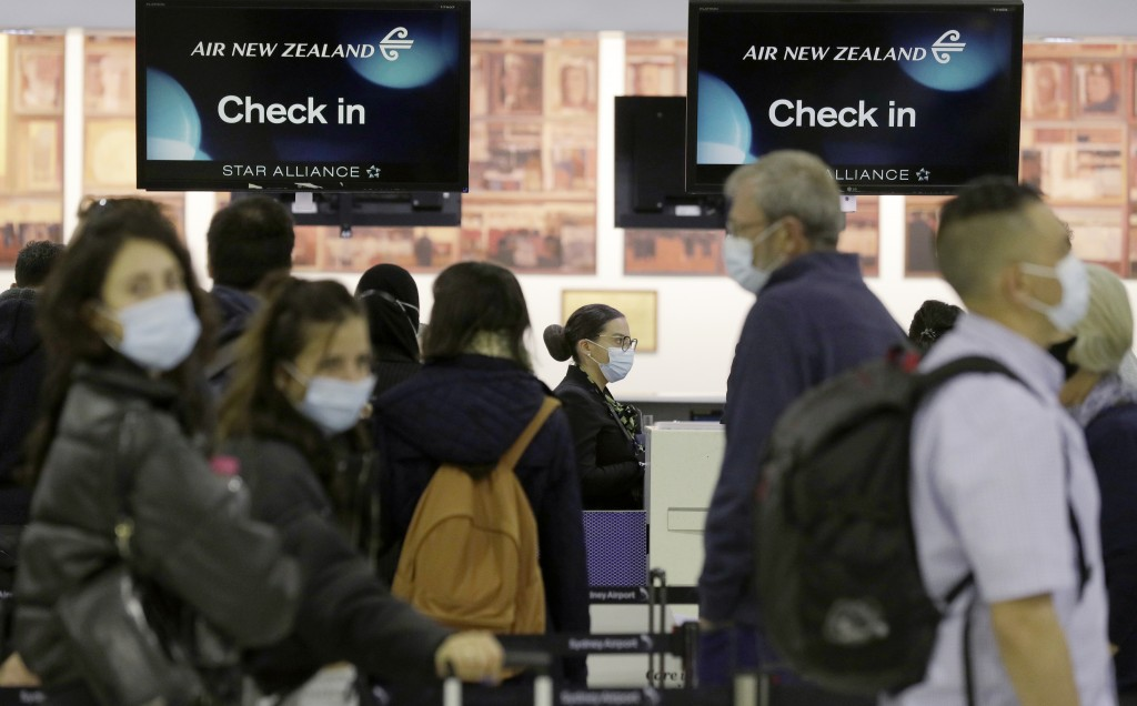 Passengers prepare at Sydney Airport, in Sydney, Australia, Monday, April 19, 2021, to catch a flight to New Zealand as the much-anticipated travel bu...