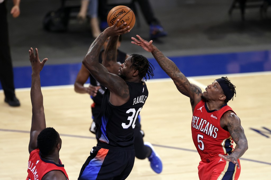 New York Knicks forward Julius Randle (30) shoots in front of New Orleans Pelicans guard Eric Bledsoe (5) during the second half of an NBA basketball ...