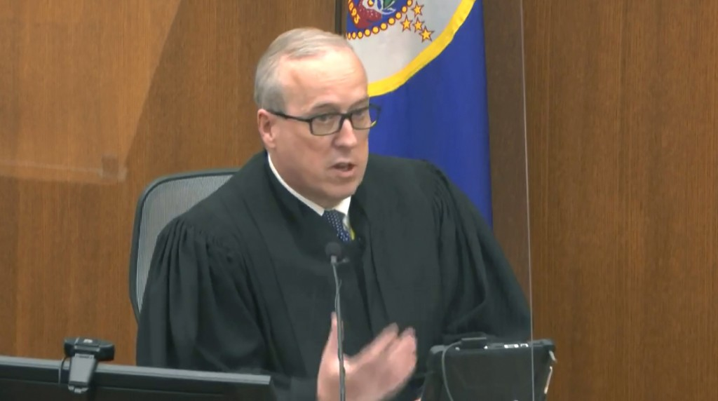 In this image from video, Hennepin County Judge PeterCahill reads instructions to the jury before closing arguments, Monday, April 19, 2021, in the t...