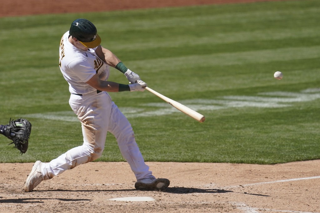 Oakland Athletics' Sean Murphy hits a solo home run against the Detroit Tigers during the eighth inning of a baseball game in Oakland, Calif., Sunday,...