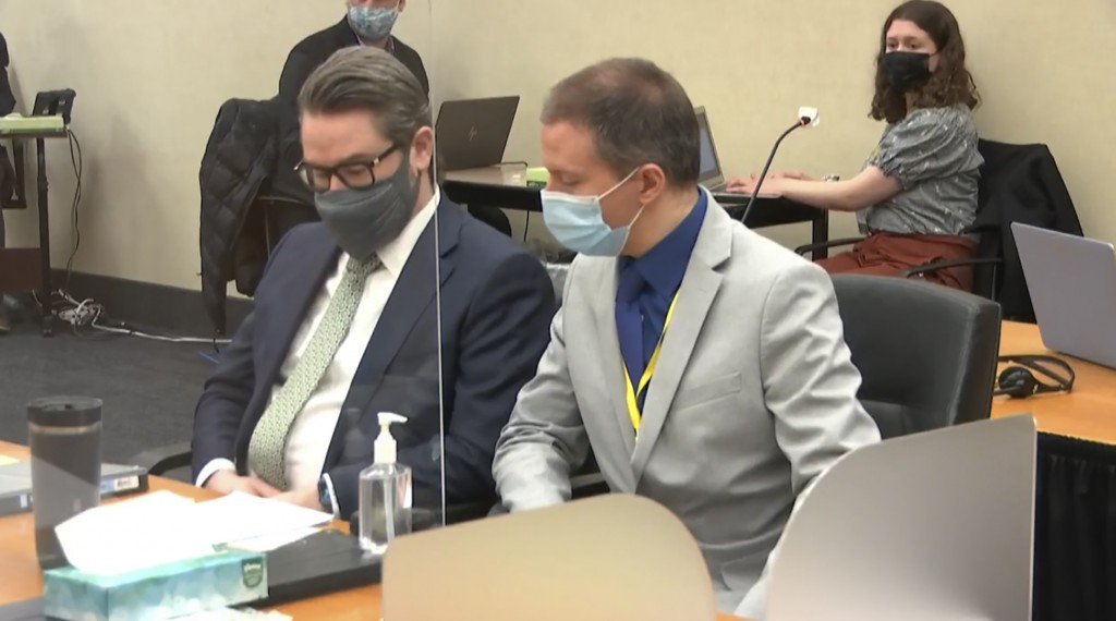 In this image from video, defense attorney Eric Nelson, left, and defendant, former Minneapolis police officer Derek Chauvin listen to Hennepin County...