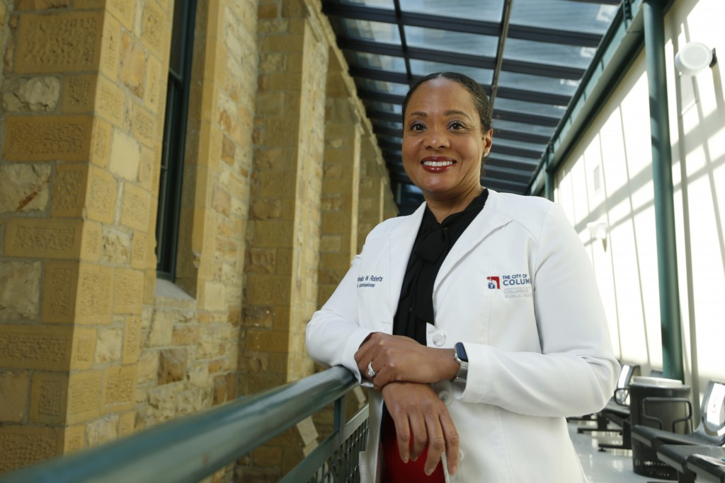 Dr. Mysheika W. Roberts, the health commissioner for Columbus Public Health, poses for a portrait in Columbus, Ohio, on Wednesday, April 14, 2021. Pub...