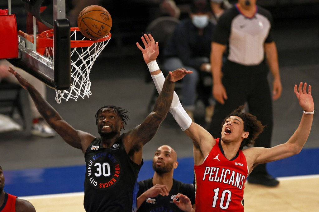 New York Knicks forward Julius Randle (30) and New Orleans Pelicans center Jaxson Hayes (10) battle for a rebound during the first half of an NBA bask...
