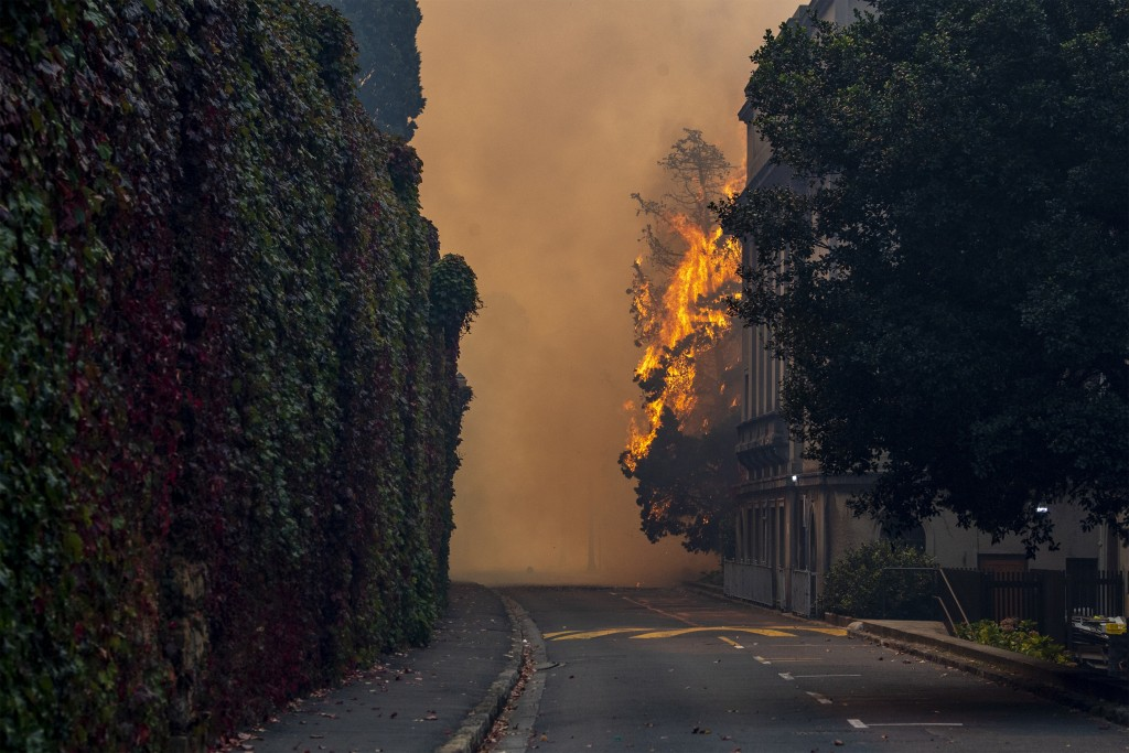 A building burns on the campus of the University of Cape, South Africa, Sunday, April 18, 2021. A wildfire raging on the slopes of the mountain forced...