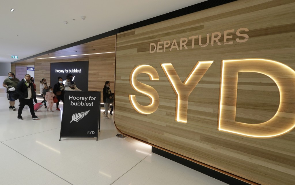 Passengers prepare at Sydney Airport to catch flights in Sydney, Australia, Monday, April 19, 2021, to New Zealand as the much-anticipated travel bubb...