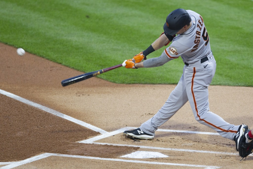 San Francisco Giants' Mike Yastrzemski hits a double during the first inning of a baseball game against the Philadelphia Phillies, Monday, April 19, 2...