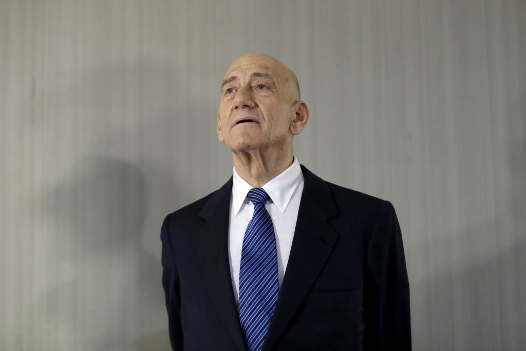 FILE - In this Feb. 11, 2020 file photo, former Israeli Prime Minister Ehud Olmert takes questions from reporters after a news conference in New York....