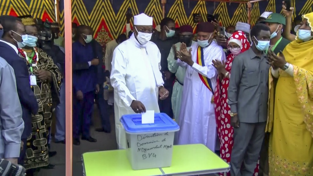 In this Sunday, April 11, 2021 image made from video, Chadian President Idriss Deby Itno, center, casts his vote in the recent elections in N'Djamena,...