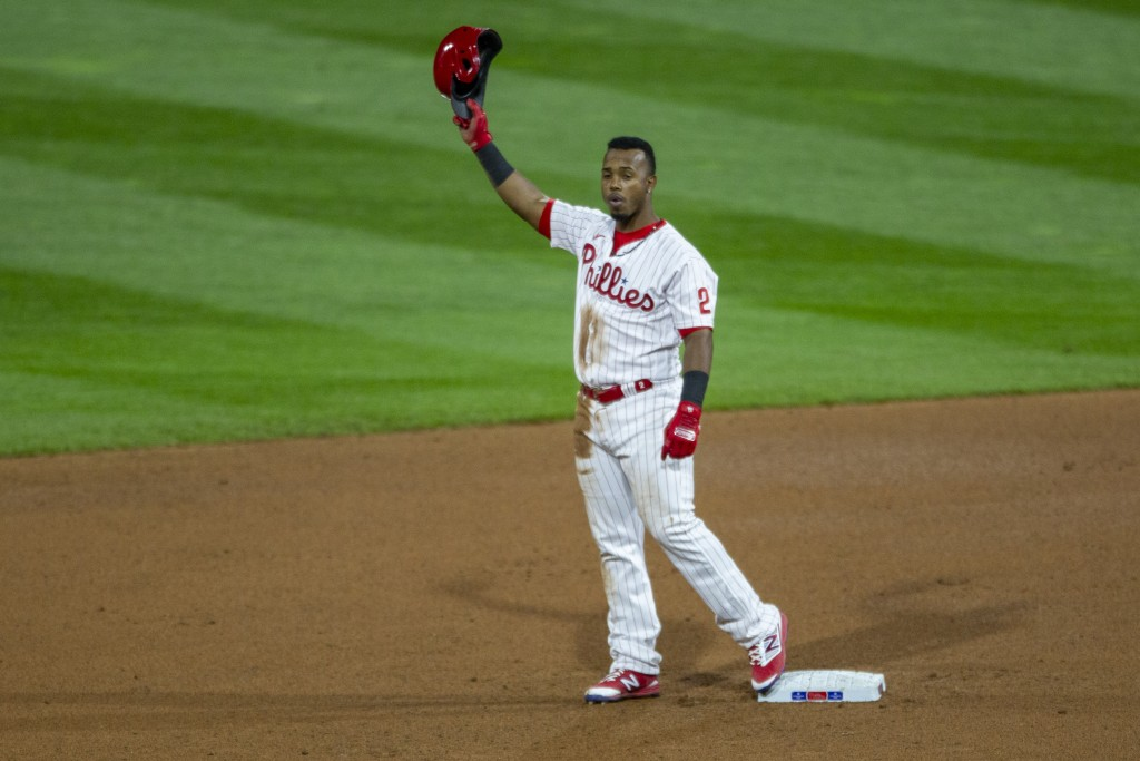 Philadelphia Phillies' Jean Segura (2) waves to the crowd after being called safe at second on a double during the fourth inning of a baseball game ag...