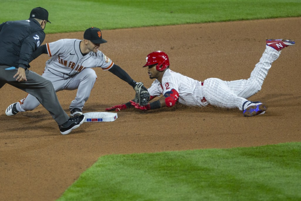 Philadelphia Phillies' Jean Segura, right, is safe at second on a double before San Francisco Giants' second baseman Tommy La Stella, center, can make...