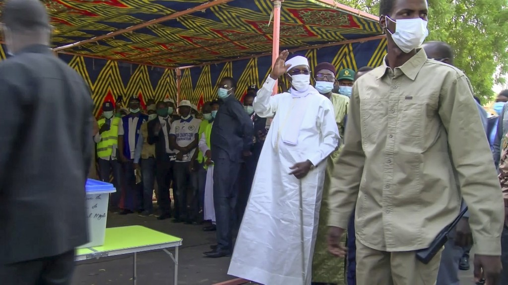 In this Sunday, April 11, 2021 image made from video, Chadian President Idriss Deby Itno, center, arrives to cast his vote in the recent elections in ...