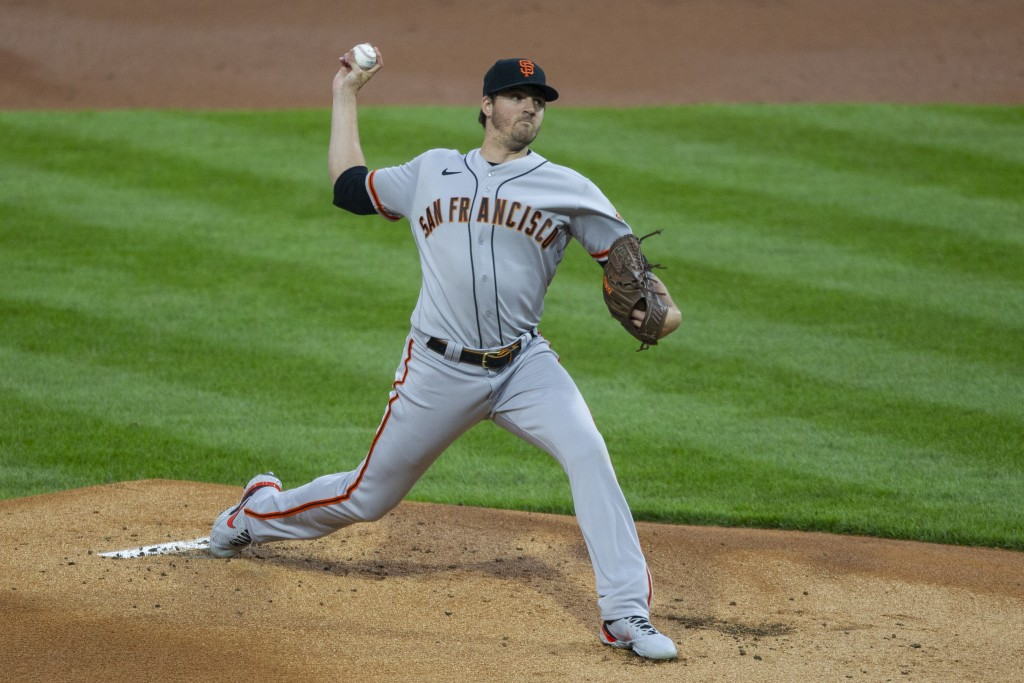 San Francisco Giants starting pitcher Kevin Gausman throws during the first inning of a baseball game against the Philadelphia Phillies, Monday, April...