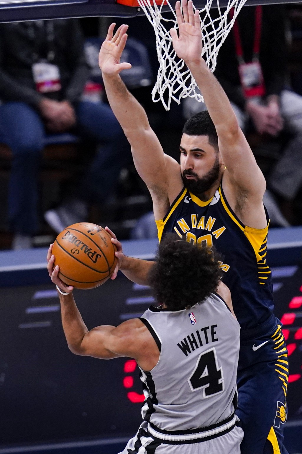 Indiana Pacers center Goga Bitadze (88) stops the shot of San Antonio Spurs guard Derrick White (4) during the first half of an NBA basketball game in...