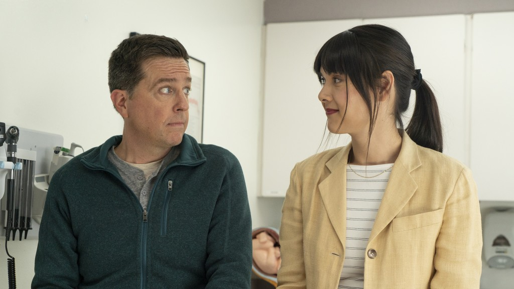 """This image released by Bleecker Street shows Ed Helms, left, and Patti Harrison in a scene from """"Together Together."""" (Tiffany Roohani/Bleecker Street ..."""
