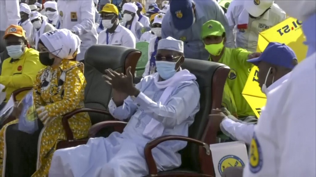 In this Friday, April 9, 2021 image made from video, Chadian President Idriss Deby Itno, center, attends his final campaign rally for the recent elect...