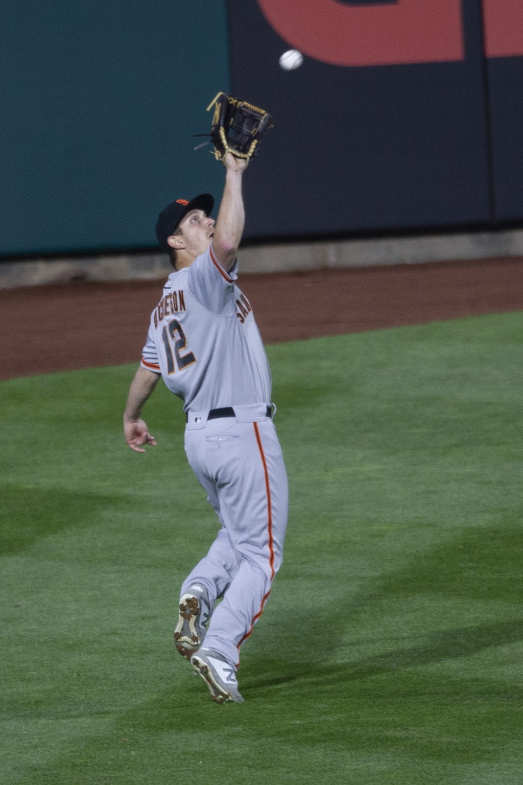 San Francisco Giants left fielder Alex Dickerson catches a fly during the second inning of a baseball game, Monday, April 19, 2021, in Philadelphia. (...