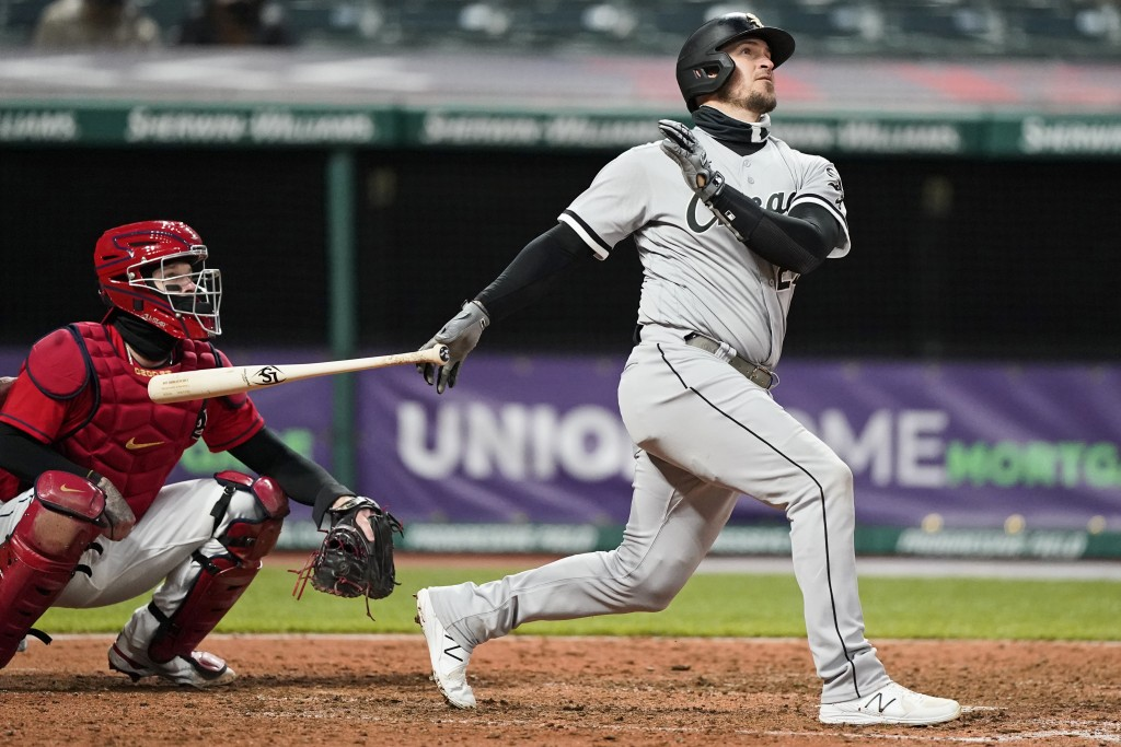 Chicago White Sox's Yasmani Grandal watches his ball after hitting a two-run home run in the sixth inning in a baseball game against the Cleveland Ind...