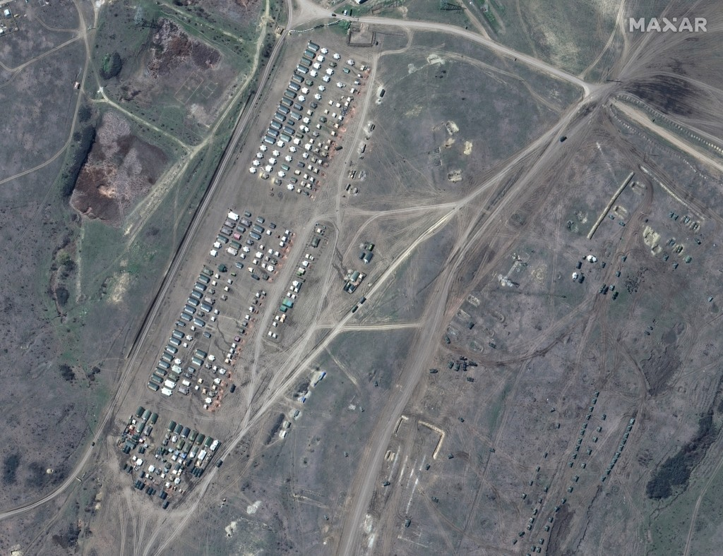 This image provided by Maxar Technologies shows overview of troop tents in Angarsky training area at the Black Sea coast of Crimea on Thursday, April ...