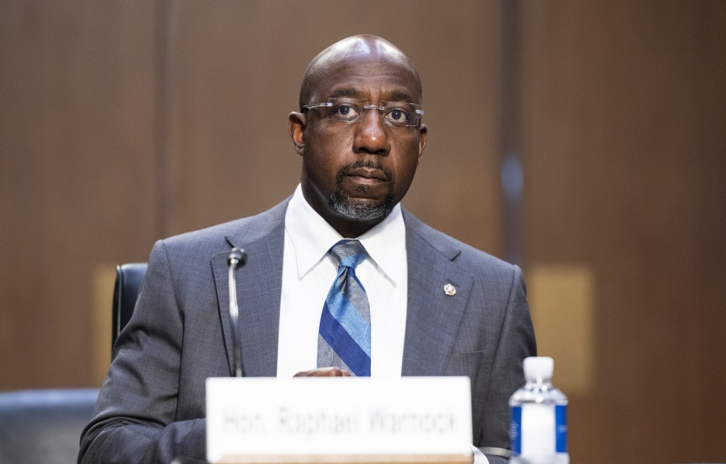 Sen. Raphael Warnock, D-Ga., testifies during a Senate Judiciary Committee hearing on voting rights on Capitol Hill in Washington, Tuesday, April 20, ...