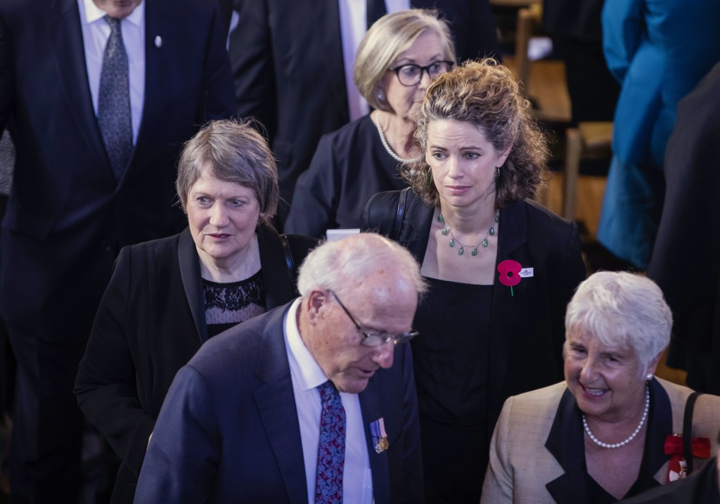 Former Prime Minister Helen Clark, left, with British High Commissioner to New Zealand Laura Clarke, center right, attend a national memorial service ...
