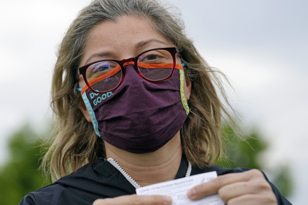 Alejandra poses with her vaccination card after getting her second Moderna COVID-19 shot Monday April 19, 2021, in Pasadena, Texas. Alejandra, a denti...