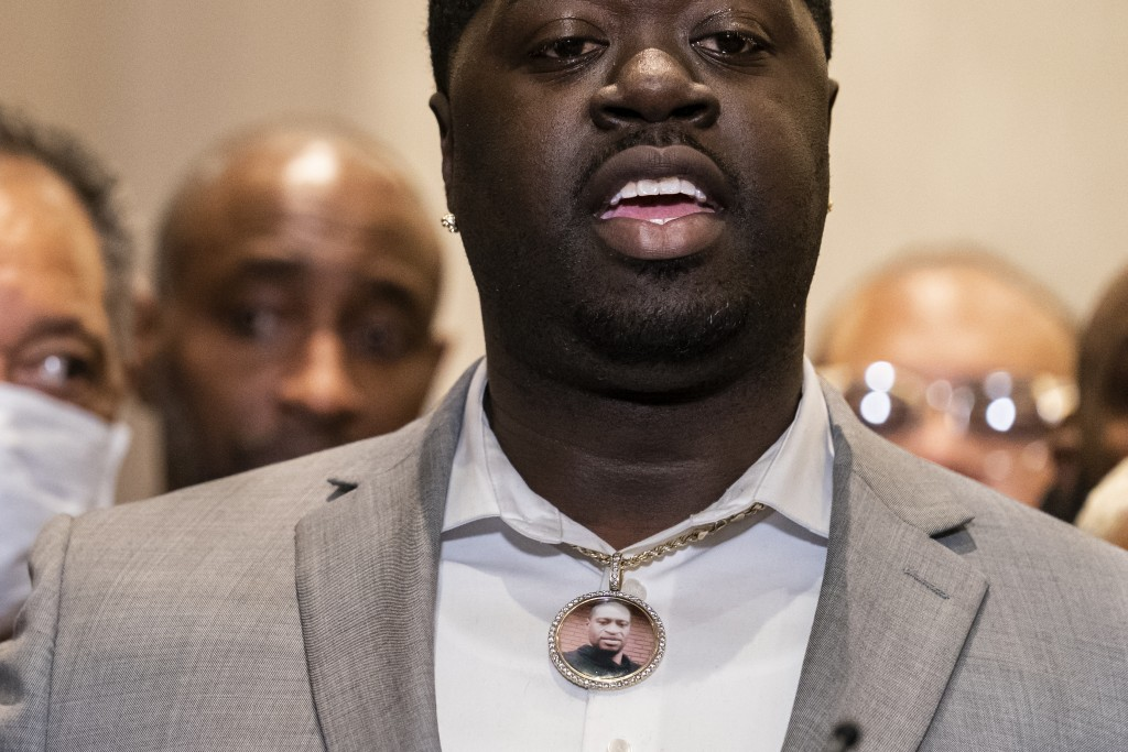 Brandon Williams, nephew of George Floyd, wears a pendant bearing the likeness of his uncle during a news conference after former Minneapolis police O...