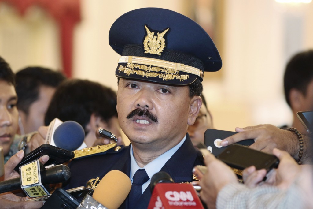 FILE - In this Jan. 18, 2017, file photo, Indonesia's then Air Force Chief of Staff Air Marshall Hadi Tjahjanto talks to journalists after his swearin...