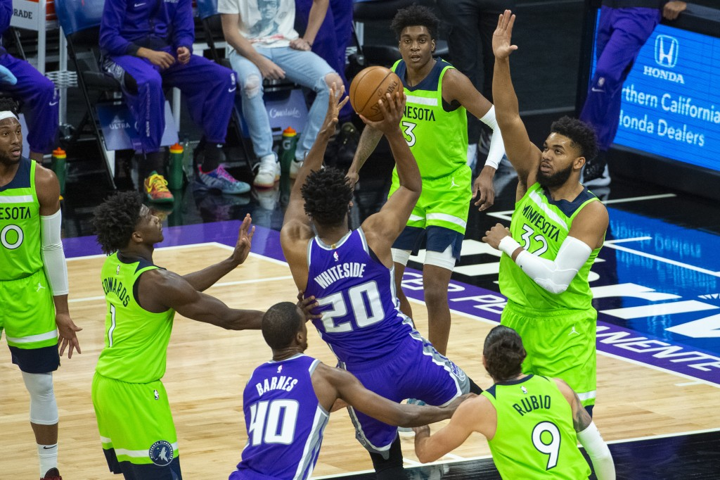 The Minnesota Timberwolves center Karl-Anthony Towns (32) defends the basket as Sacramento Kings center Hassan Whiteside (20) shoots during the first ...