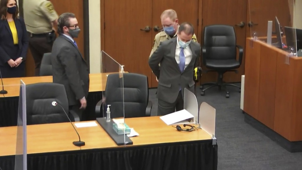 In this image from video, former Minneapolis police Officer Derek Chauvin is taken into custody as his attorney, Eric Nelson, left, looks on, after th...