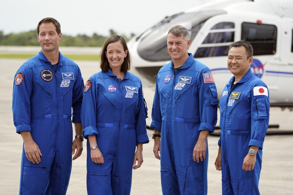 FILE - In this Friday, April 16, 2021 file photo, SpaceX Crew 2 members, from left, European Space Agency astronaut Thomas Pesquet, NASA astronauts Me...