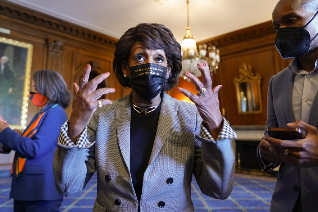 Rep. Maxine Waters, D-Calif., talks on Capitol Hill in Washington on Tuesday, April 20, 2021, as she waits for the verdict to be read in the murder tr...
