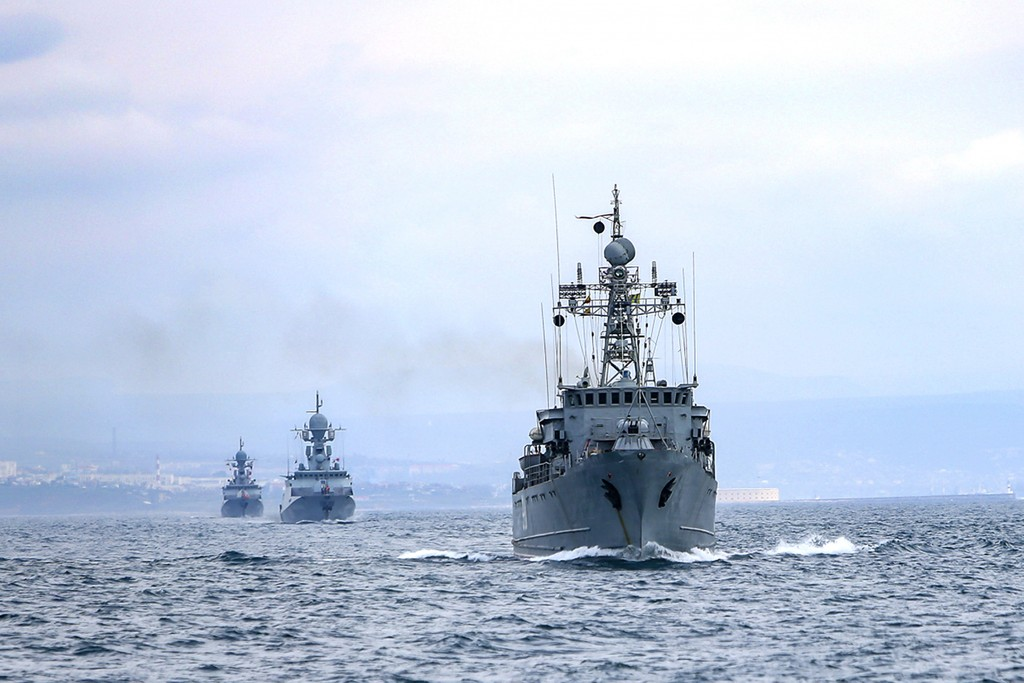 This handout photo released on Wednesday, April 14, 2021 by Russian Defense Ministry Press Service shows, Russian navy ships are seen during navy dril...