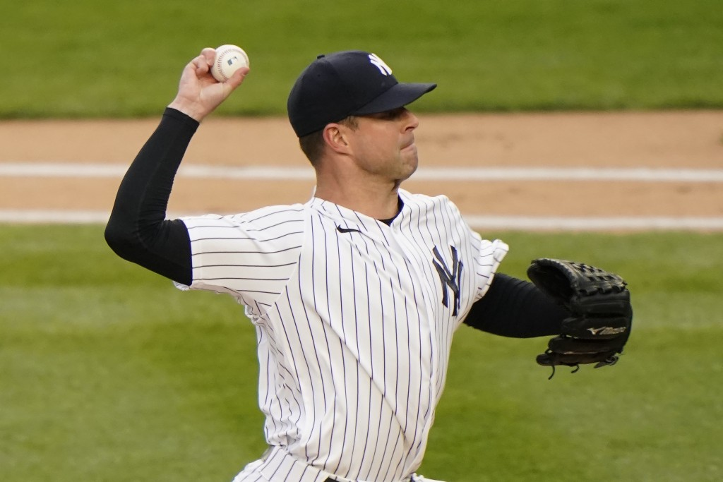 New York Yankees starting pitcher Corey Kluber throws to an Atlanta Braves batter during the first inning of a baseball game Wednesday, April 21, 2021...