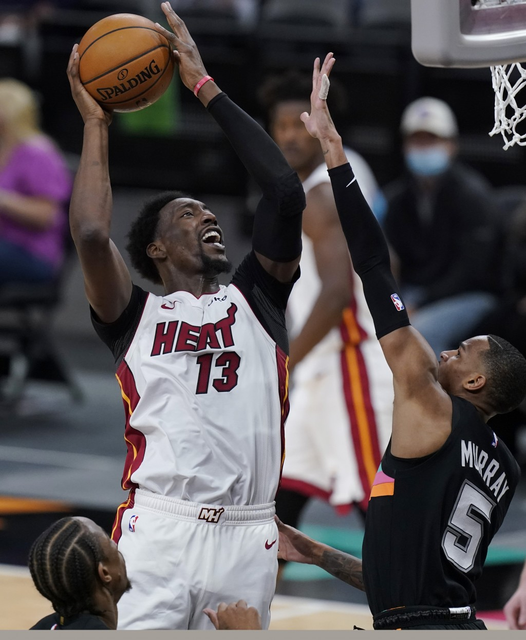 Miami Heat center Bam Adebayo (13) shoots over San Antonio Spurs guard Dejounte Murray (5) during the second half of an NBA basketball game in San Ant...