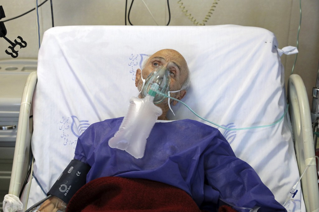 A COVID-19 patient is treated in the ICU unit of the Shohadaye Tajrish Hospital in Tehran, Iran, Saturday, April 17, 2021. After facing criticism for ...
