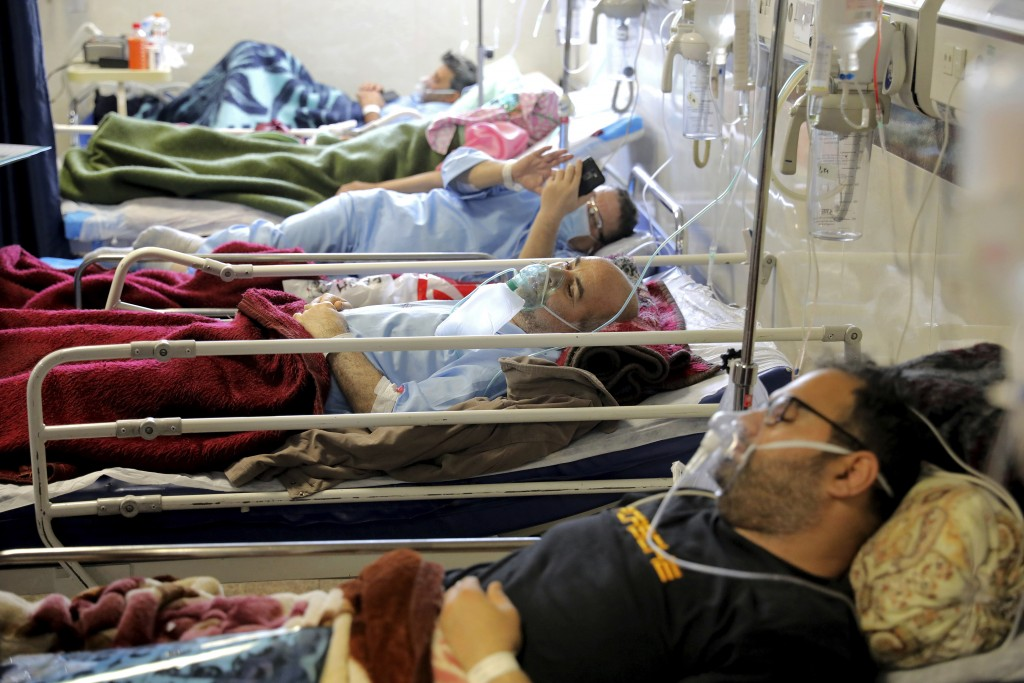 COVID-19 patients are treated at the Shohadaye Tajrish Hospital in Tehran, Iran, Saturday, April 17, 2021. After facing criticism for downplaying the ...
