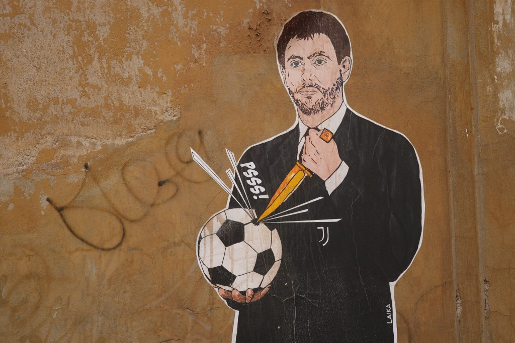 A mural depicting Juventus president Andrea Agnelli making a hole in a football with a knife, appeared in Rome, Thursday, April 22, 2021. Juventus was...